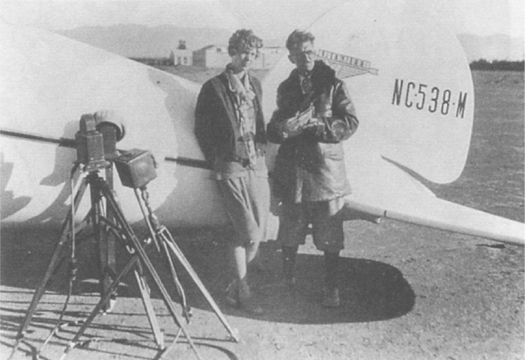 Amelia with Joe Nikrent, official timer of the NAA's Los Angeles chapter, after breaking the women's speed record in November 1929.